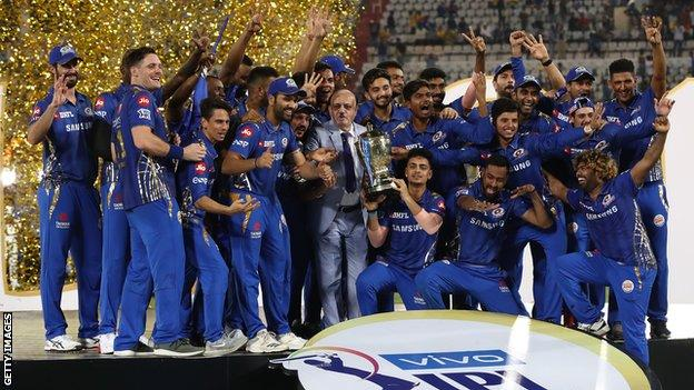 Mumbai Indians players celebrate on the podium after winning the 2019 IPL title