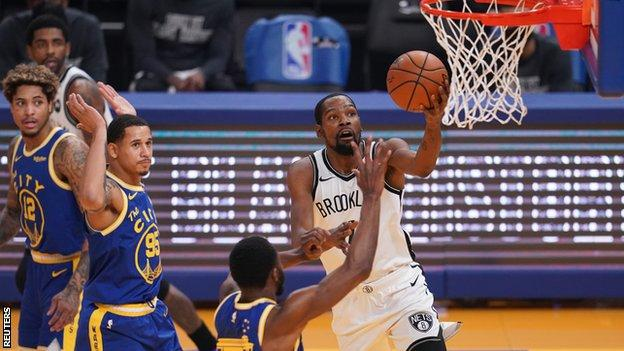 Brooklyn Nets forward Kevin Durant shoots the ball against the Golden State Warriors