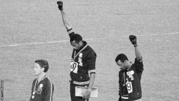 Tommie Smith (centre) and John Carlos make a black power salute on the podium at the 1968 Olympic Games
