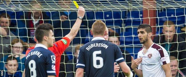 Igor Rossi is shown yellow for felling Ross County's Jackson Irvine
