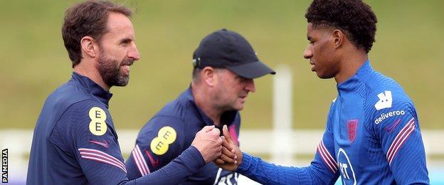 England manager Gareth Southgate and Marcus Rashford