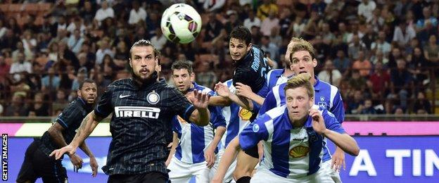 Inter Milan forward Pablo Osvaldo fights for the ball with Stjarnan's Hordur Arnason in their Europa League play-off match in August