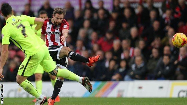 Brentford's Alan Judge shoots for goal against Brighton