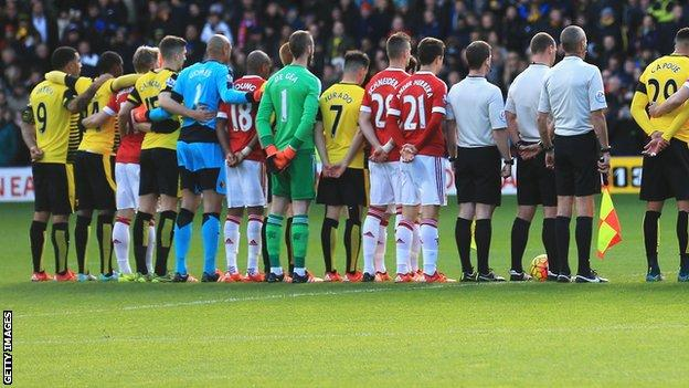 Watford and Manchester United players line up in the centre circle before Saturday's game
