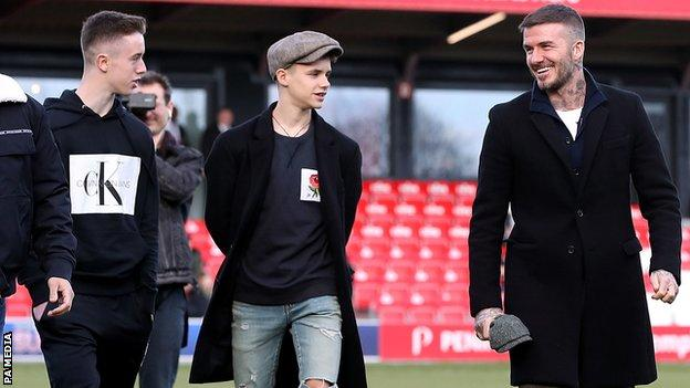 Harvey Neville and Romeo Beckham