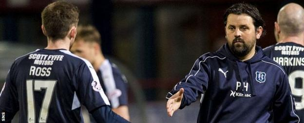 Dundee's Nick Ross is congratulated by manager Paul Hartley