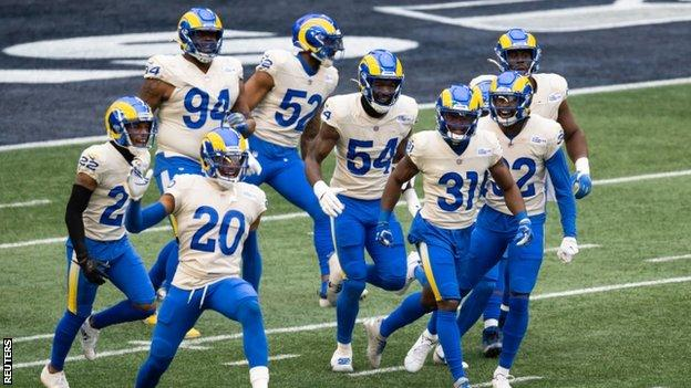 The Los Angeles Rams celebrate a touchdown by Darious Williams