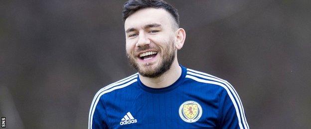 Robert Snodgrass smiles during Scotland training