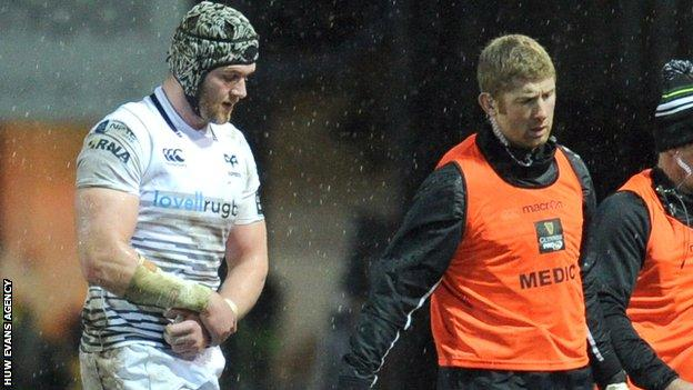 Dan Lydiate is substituted clutching his arm during the Ospreys' game against the Dragons