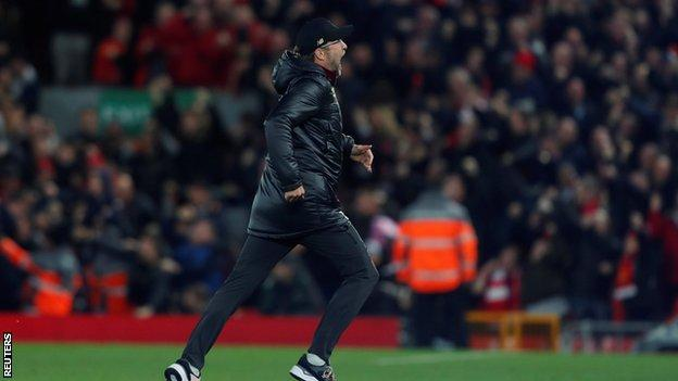 Jurgen Klopp races on to the pitch at Anfield