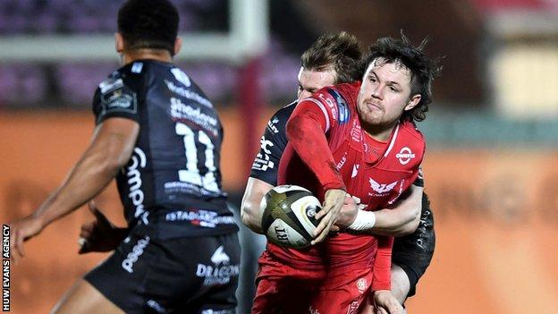 Scarlets' Steff Evans takes on Dragons