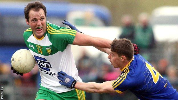 Donegal captain Michael Murphy is challenged by Roscommon's Niall McInerney at Letterkenny