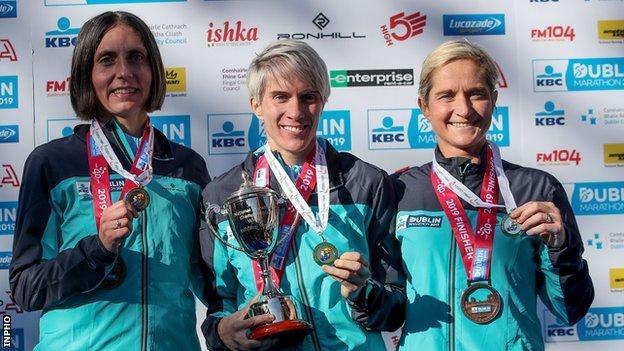 Gladys Ganiel, women's Irish title winner Aoife Cooke and Ann-Marie McGlynn on the podium