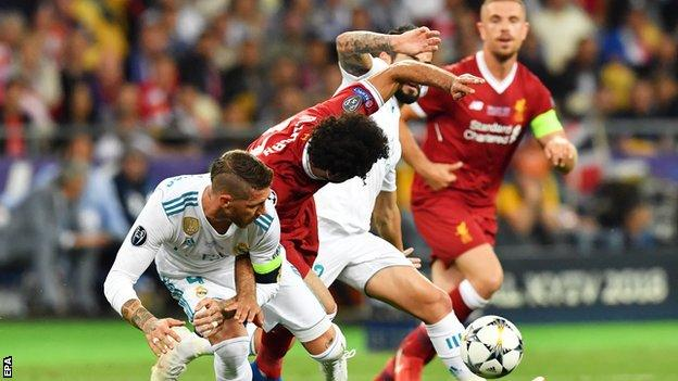 Salah damaged his shoulder under challenge from Sergio Ramos