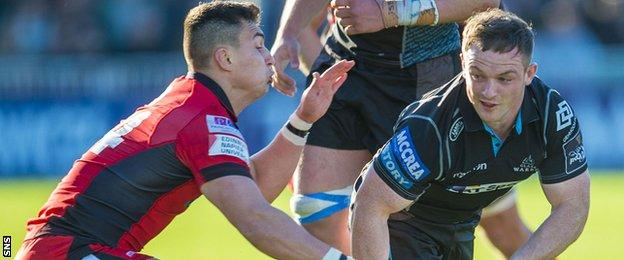Damien Hoyland of Edinburgh tackles Glasgow Warriors' Nick Grigg