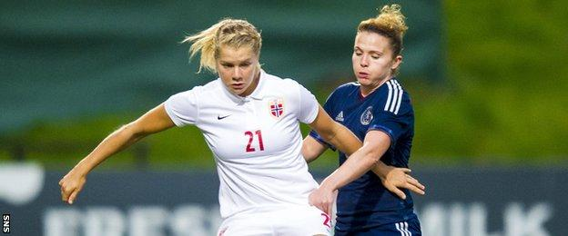 Norway's Ada Stolsmo Hegerberg (left) battles with Joanne Love
