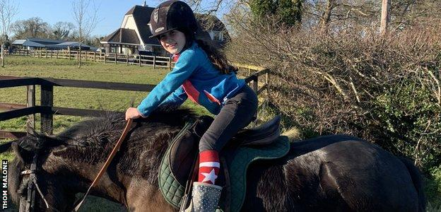 Maisy's Dad Thom tweeted that his daughter was inspired by Rachael Blackmore's performances. Here she is with her pony, Burt