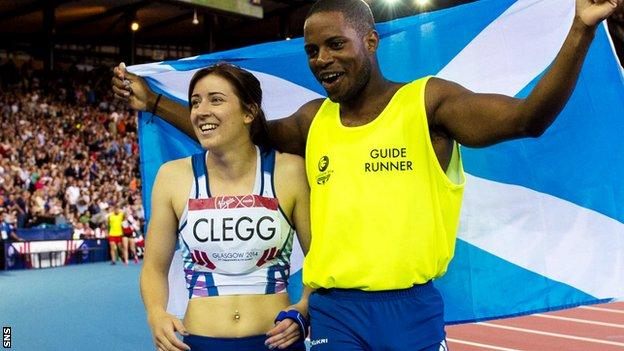 Libby Clegg and guide runner Mikail Huggins celebrate winning the Women's Para-Sport 100m T12 at Glasgow 2014