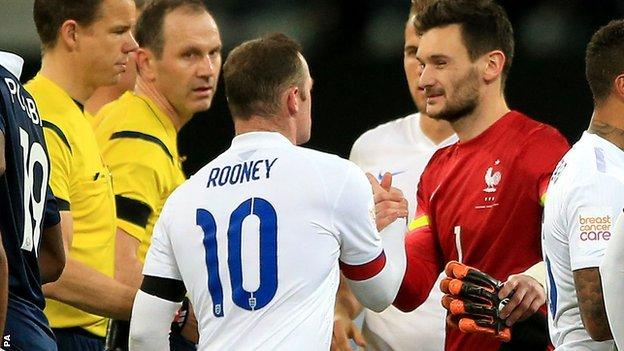 Wayne Rooney and Hugo Lloris