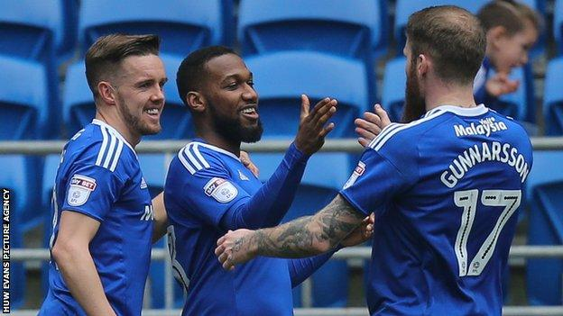 Junior Hoilett celebrates with Craig Noone and Aron Gunnarsson after scoring Cardiff's second goal
