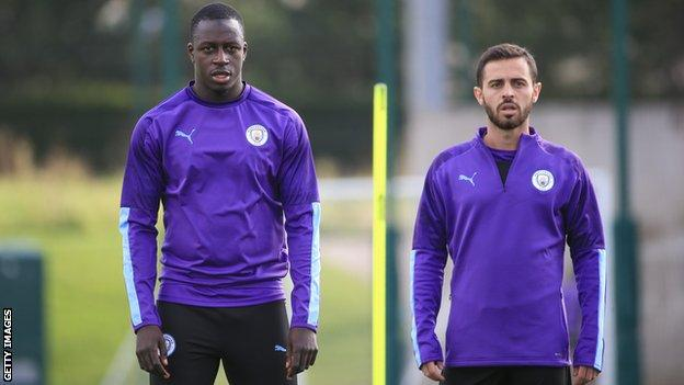 Manchester City players Benjamin Mendy (left) and Bernardo Silva (right) in training