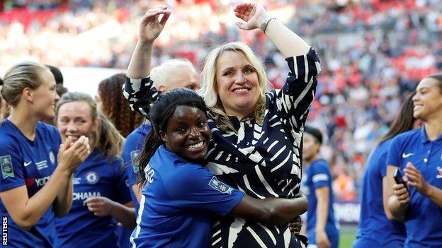 Chelsea striker Eniola Aluko hugs manager Emma Hayes after winning the FA Cup