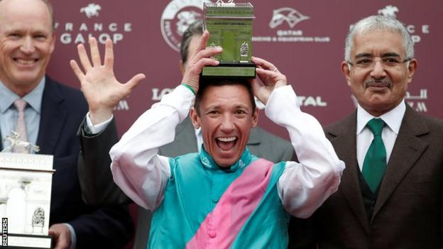 Frankie Dettori with the trophy following his victory.