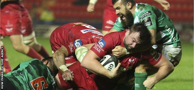 David Bulbring of Scarlets is held short of the try line