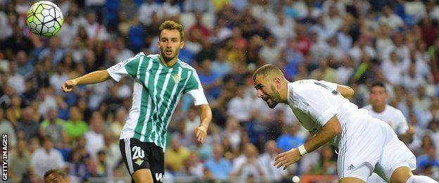 Karim Benzema heads a goal for Real Madrid