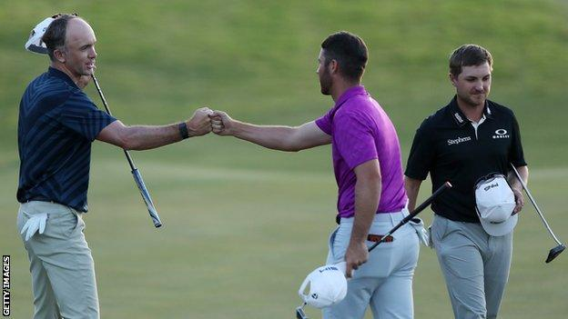 Martin Laird is congratulated by Matthew Wolff in Las Vegas