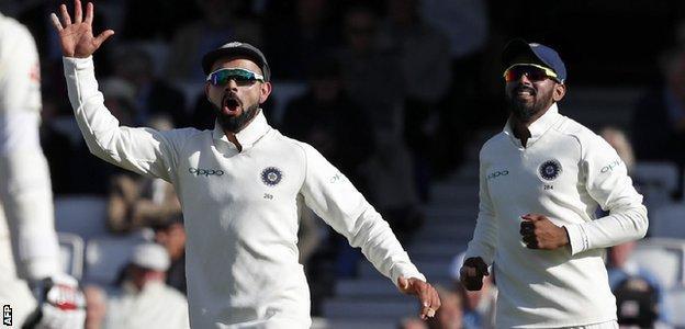 Virat Kohli celebrates a wicket