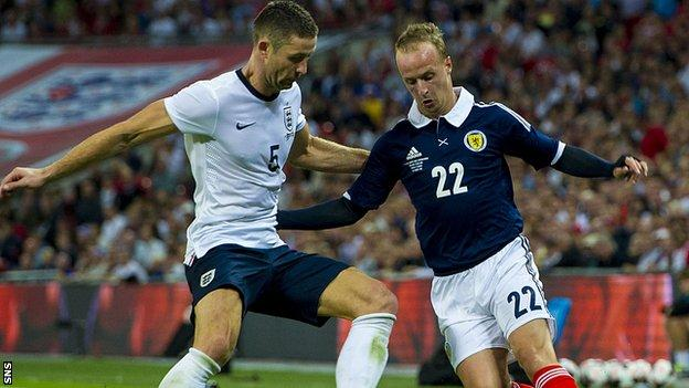 Gary Cahill and Leigh Griffiths (right)