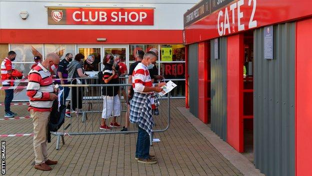 Gloucester Rugby fans queue up before a Premiership Rugby match against Harlequins in September in a pilot event