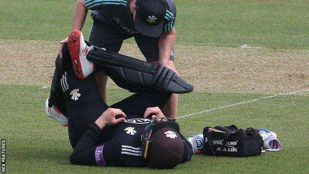Jason Roy down receiving treatment for a back spasm