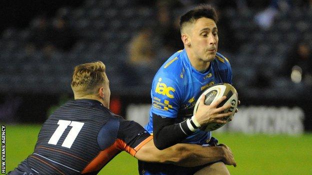 Dragons' Sam Davies is tackled by Edinburgh's Duhan van der Merwe