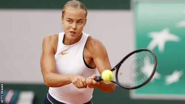 Anna Karolina Schmiedlova hits a backhand