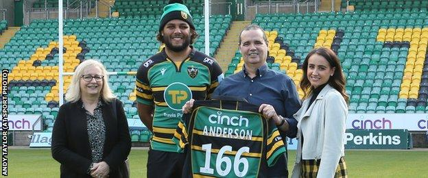 Martin Faulkner (holding the shirt), with his wife Tracey (left), daughter Amelia (right) and Saints player Lewis Ludlam