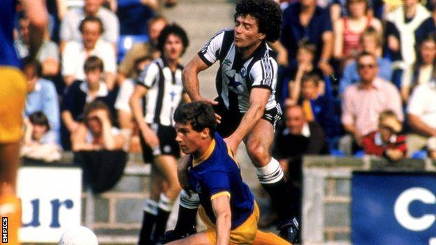 Former England captain Kevin Keegan is tackled by Nigel Pearson in Newcastle's trip to Shrewsbury in 1982