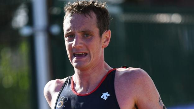 Alistair Brownlee is disqualified in Australia as Mario Mola wins triathlon title