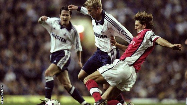 Tony Adams makes a tackle