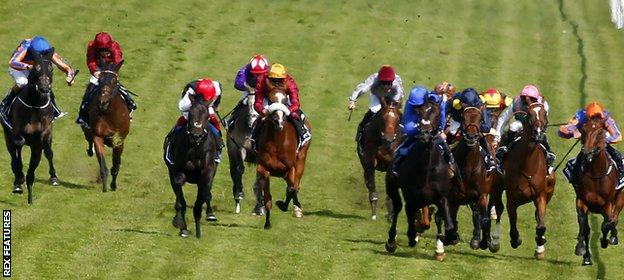 Horses compete in the 2015 Epsom Derby