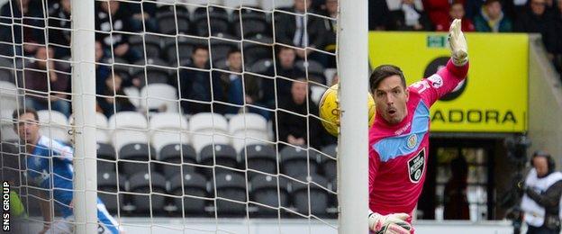 St Mirren goalkeeper Jamie Langfield watches as Jason Holt's shot hits the target