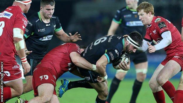 Scarlets and Ospreys in action during their Pro12 derby earlier this season