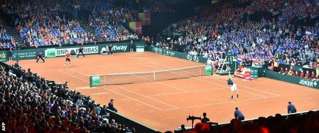 Kyle Edmund plays David Goffin in the Davis Cup final at the Flanders Expo