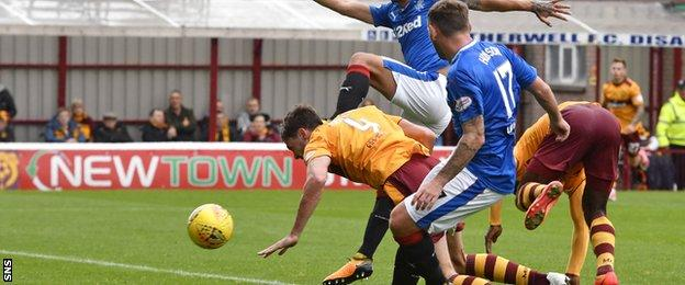 Ben Heneghan dives forward to head home Motherwell's equaliser