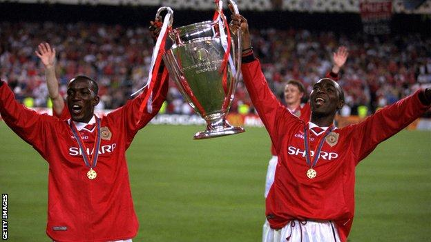 Andy Cole and Dwight Yorke celebrate with the Champions League trophy