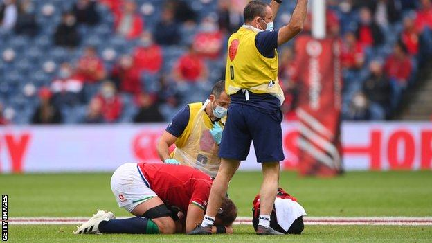 Alun Wyn Jones on the ground with his head in his hands
