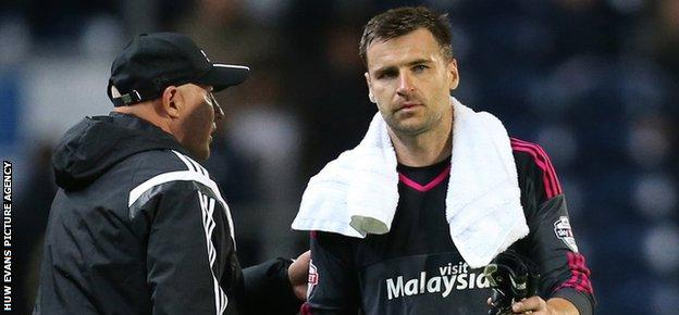 Cardiff boss Russell Slade with goalkeeper David Marshall