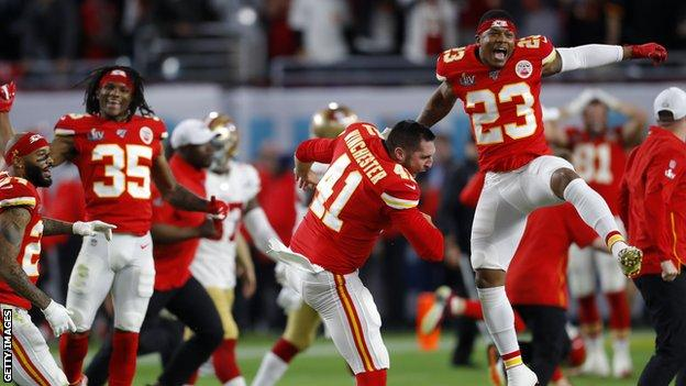 Chiefs players celebrate after the final play of the game