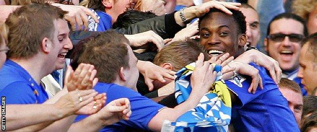Michael Essien is mobbed by Chelsea fans